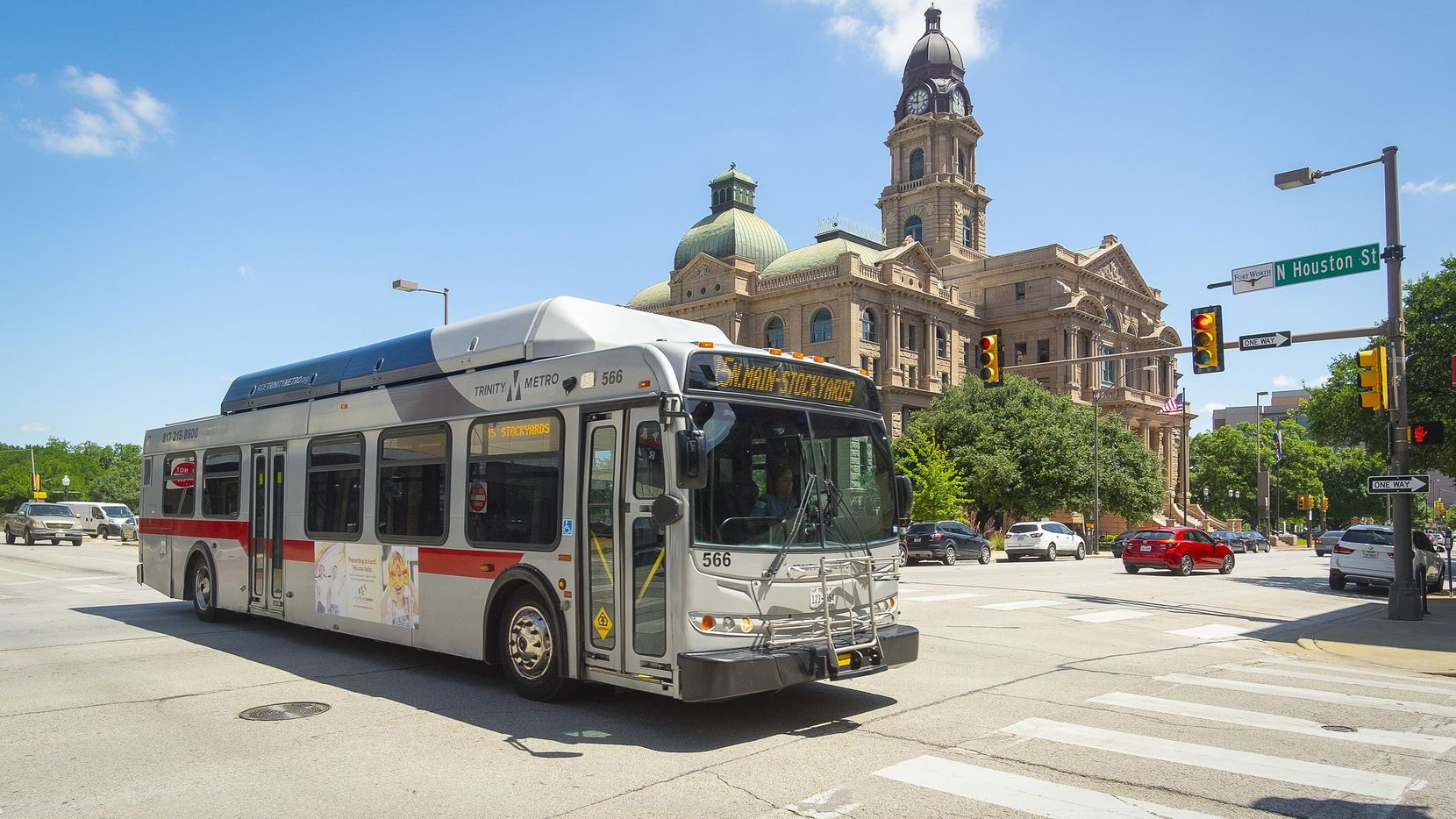 A Trinity Metro bus passes the Tarrant County Courthouse. May 30, 2019. The Tarrant County bus service is offering free rides to COVID-19 vaccination sites.