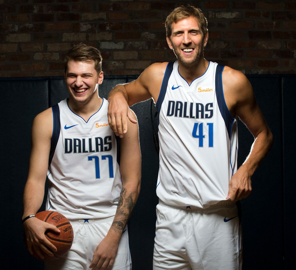 Dallas Mavericks Luka Doncic (left) and Dirk Nowitzki poses for a photo during Dallas Mavericks Media Day at the American Airlines Center in Dallas, Friday, September  21, 2018. (Tom Fox/The Dallas Morning News)