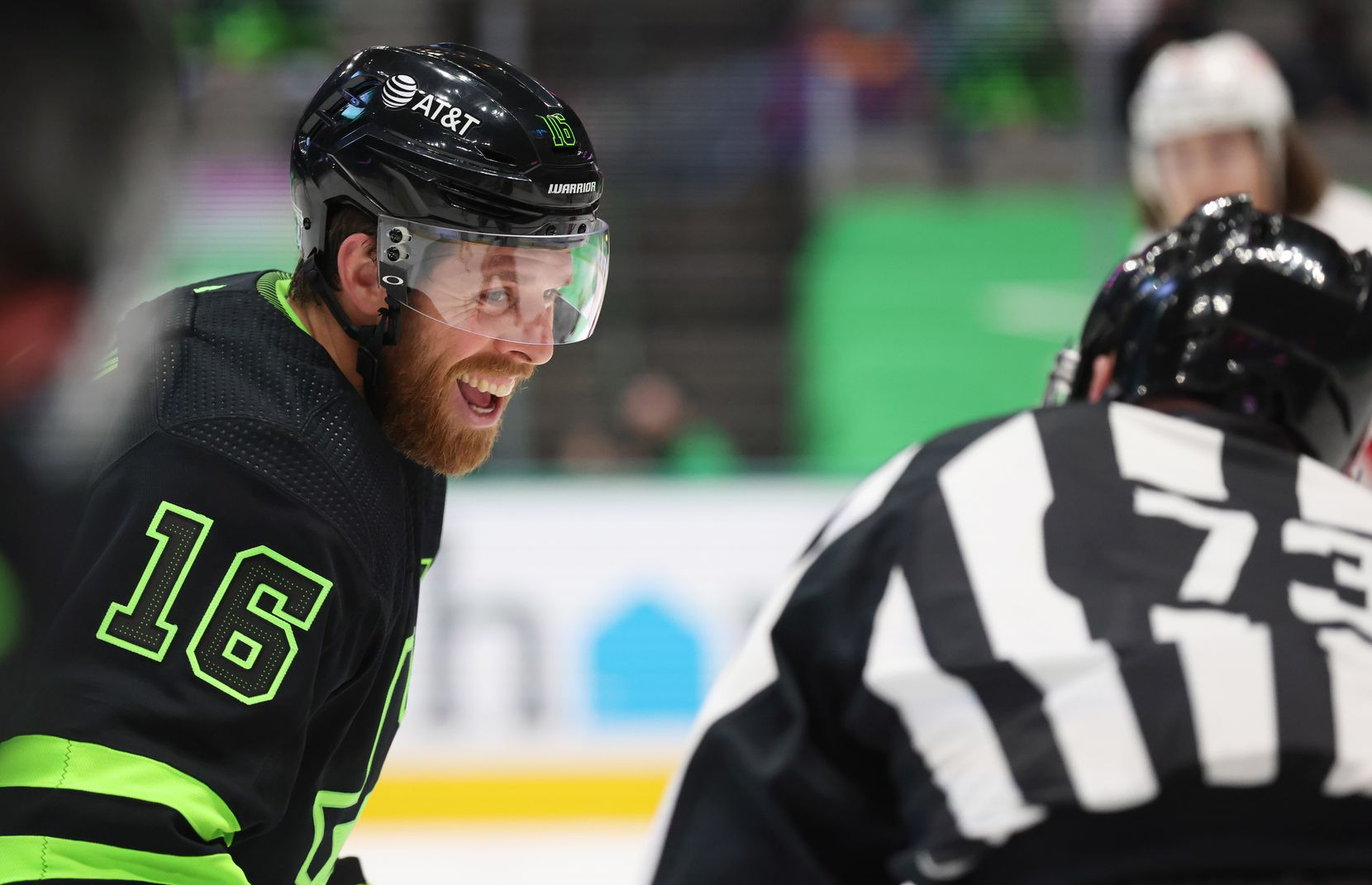 Dallas Stars center Joe Pavelski (16) laughs with linesman Vaughan Rody (73) before a faceoff in a game against the Detroit Red Wings during the first period of play at American Airlines Center on Thursday, January 28, 2021in Dallas. (Vernon Bryant/The Dallas Morning News)