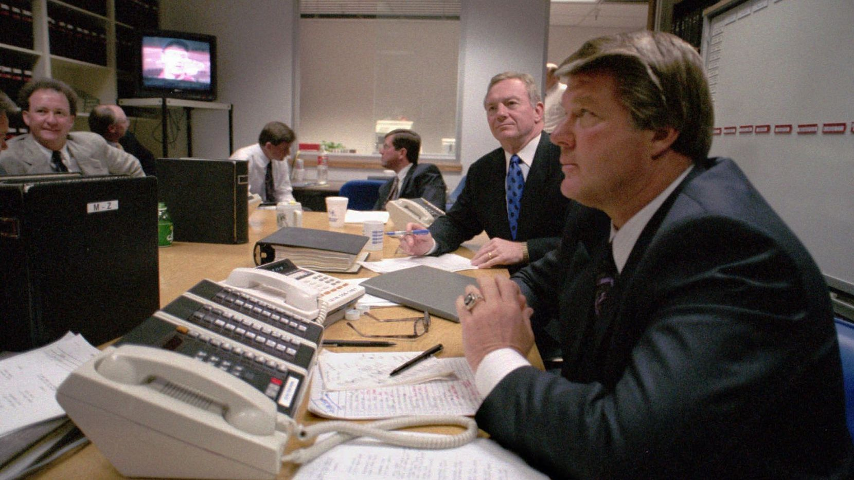 Dallas Cowboys coach Jimmy Johnson (right) sits with team owner Jerry Jones (second from right) in a calm and quiet war room at the team's office at Valley Ranch in Irving, Texas, during the NFL draft in 1993.