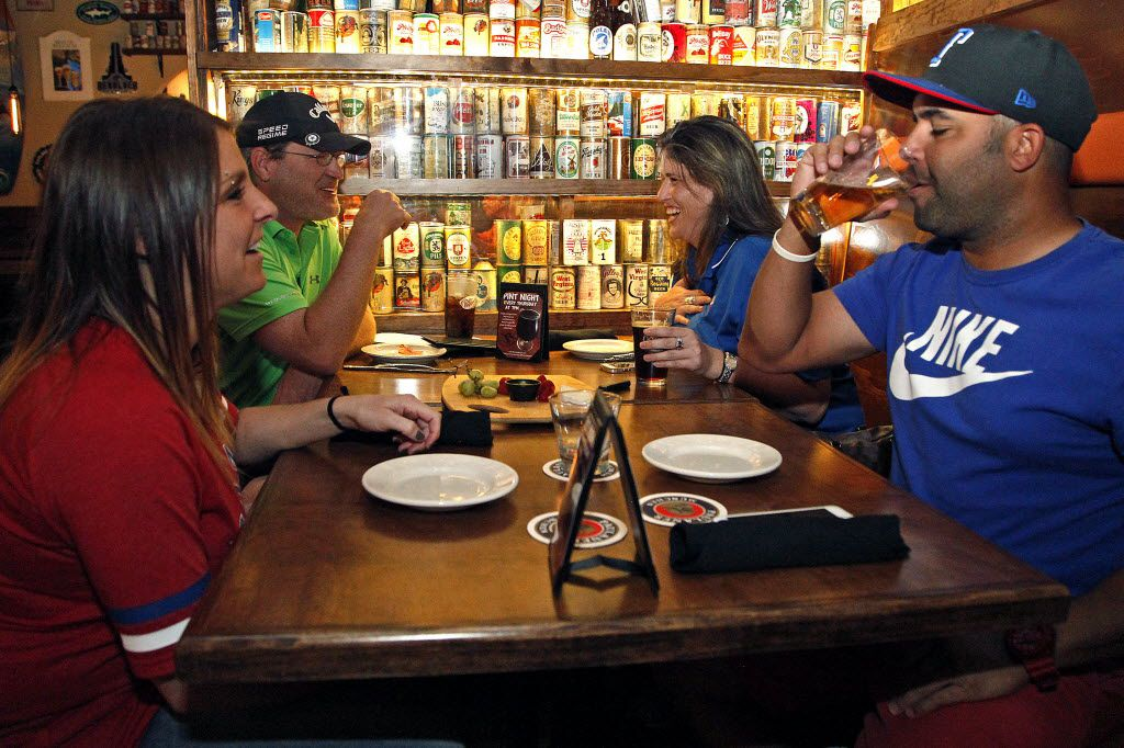 Michell Bradford (left) of Carrollton, Jeff Noble (left center) of Dallas, Diana Dean of Dallas, and Luke Benson (right) of Plano, enjoy the atmosphere at Ron's Place in Addison on Friday, October 1, 2015.