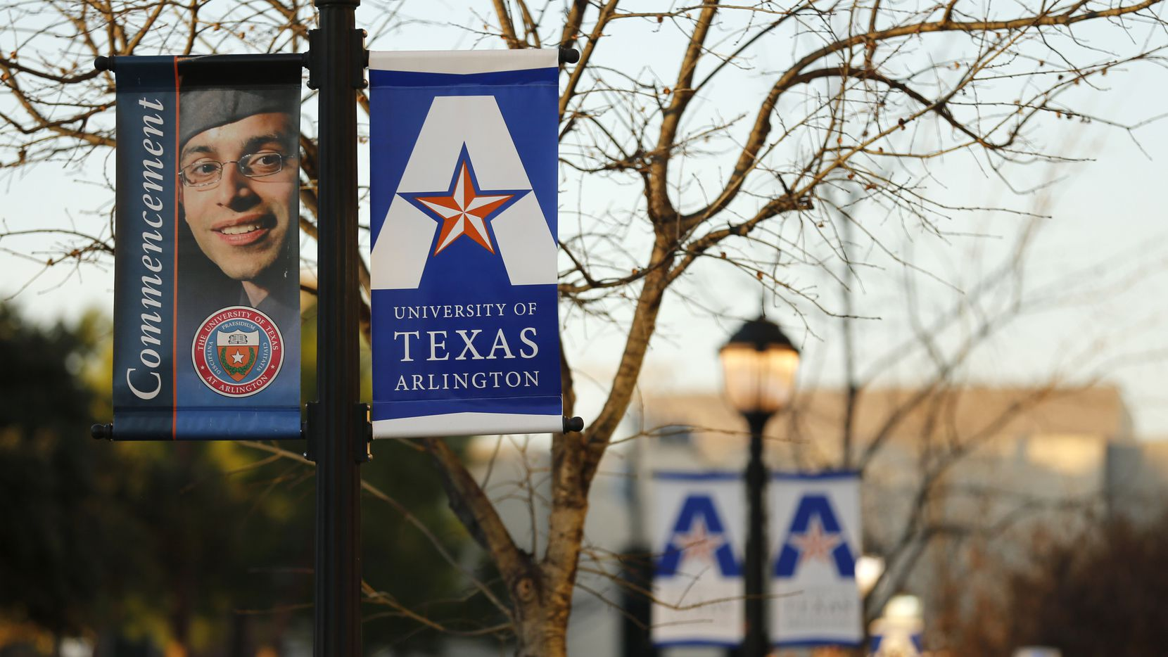 University of Texas at Arlington banners announcing commencement near College Park Center at the UTA in Arlington, Texas on Friday, December 13, 2019.