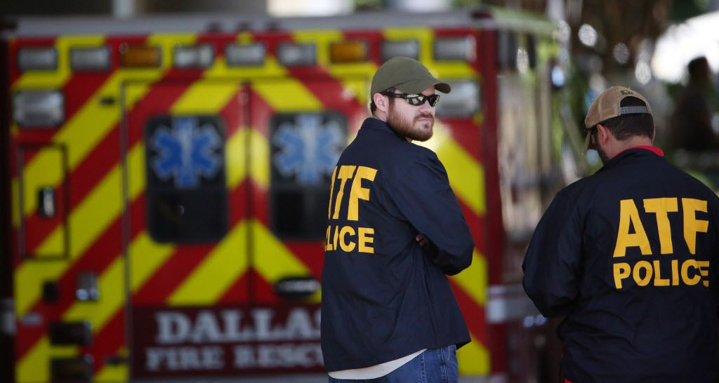An ATF agents stands while authorities react outside of the Baylor University Medical Center at Dallas emergency room after a Dallas Fire-Rescue paramedic was transported there after being shot on Monday May 1, 2017. The firefighter paramedic was rushed to the hospital in the back of a police squad car. The firefighter was shot around 11:30 a.m. in the 3200 block of Reynolds Avenue, near Dolphin Road in Old East Dallas, along with a neighbor. (Andy Jacobsohn/The Dallas Morning News)