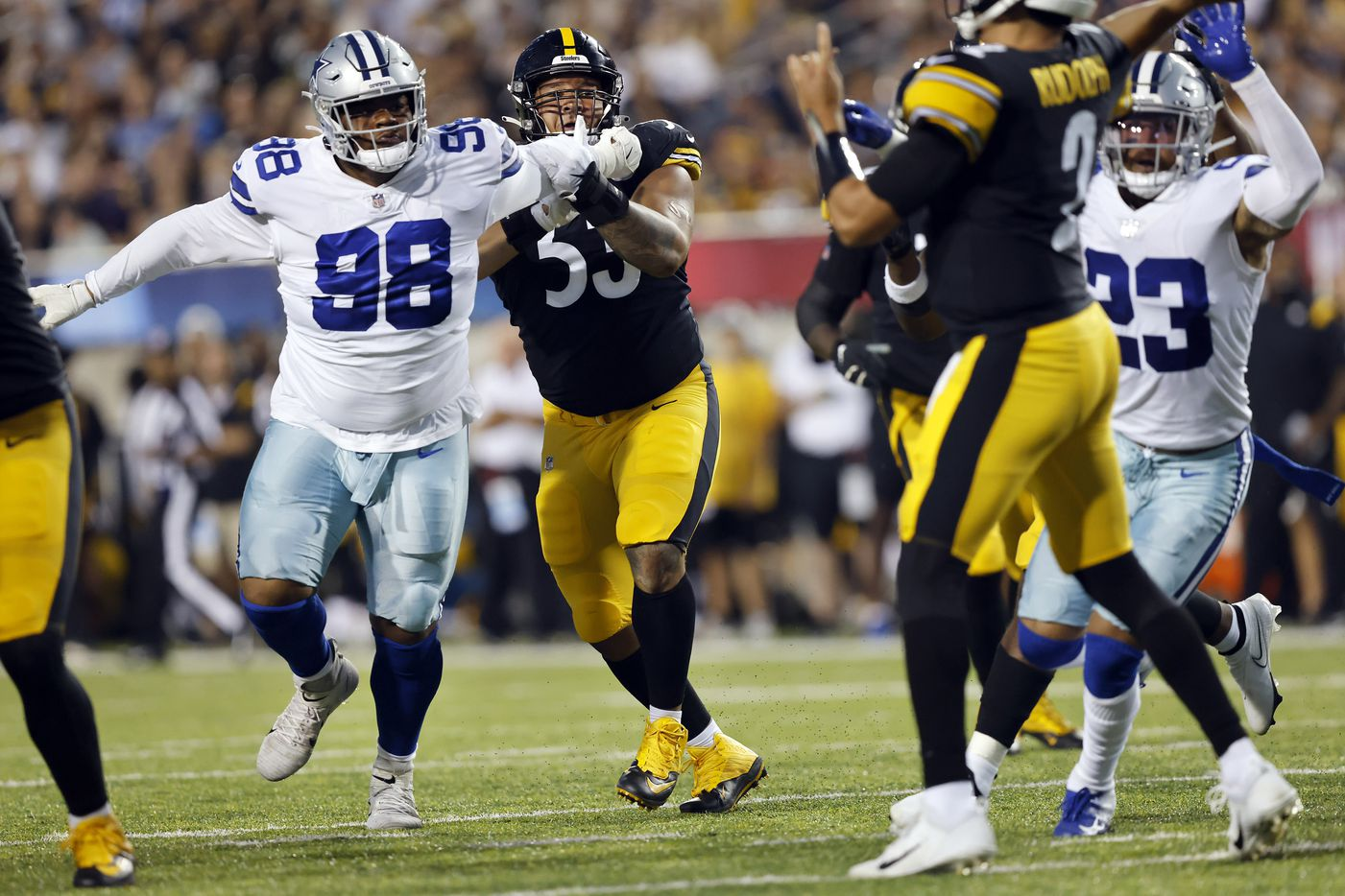 Dallas Cowboys defensive tackle Quinton Bohanna (98) fights off Pittsburgh Steelers center Kendrick Green (53) as he tries to get to quarterback Mason Rudolph (2) during the first quarter of their preseason game at Tom Benson Hall of Fame Stadium in Canton, Ohio, Thursday, August 5, 2021. (Tom Fox/The Dallas Morning News)