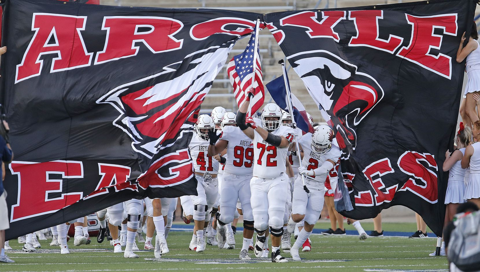 The Argyle High School football team takes the field before kickoff as they hosted Nolan Catholic High School at Eagle Stadium in Allen on Saturday evening, August 28, 2021. (Stewart F. House/Special Contributor)