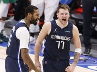 Dallas Mavericks guard Luka Doncic (77) celebrates his game-winning shot with forward James Johnson (16) in the fourth quarter against the Boston Celtics at the American Airlines Center in Dallas, Tuesday, February 23, 2021. (Tom Fox/The Dallas Morning News)