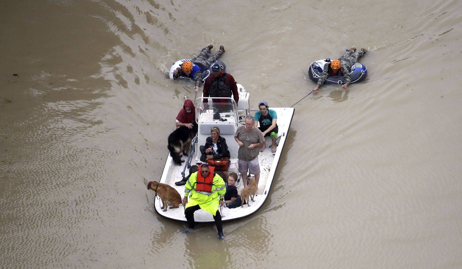Evacuees make their way though floodwaters near the Addicks Reservoir as floodwaters from Tropical Storm Harvey rise Tuesday, Aug. 29, 2017, in Houston.
