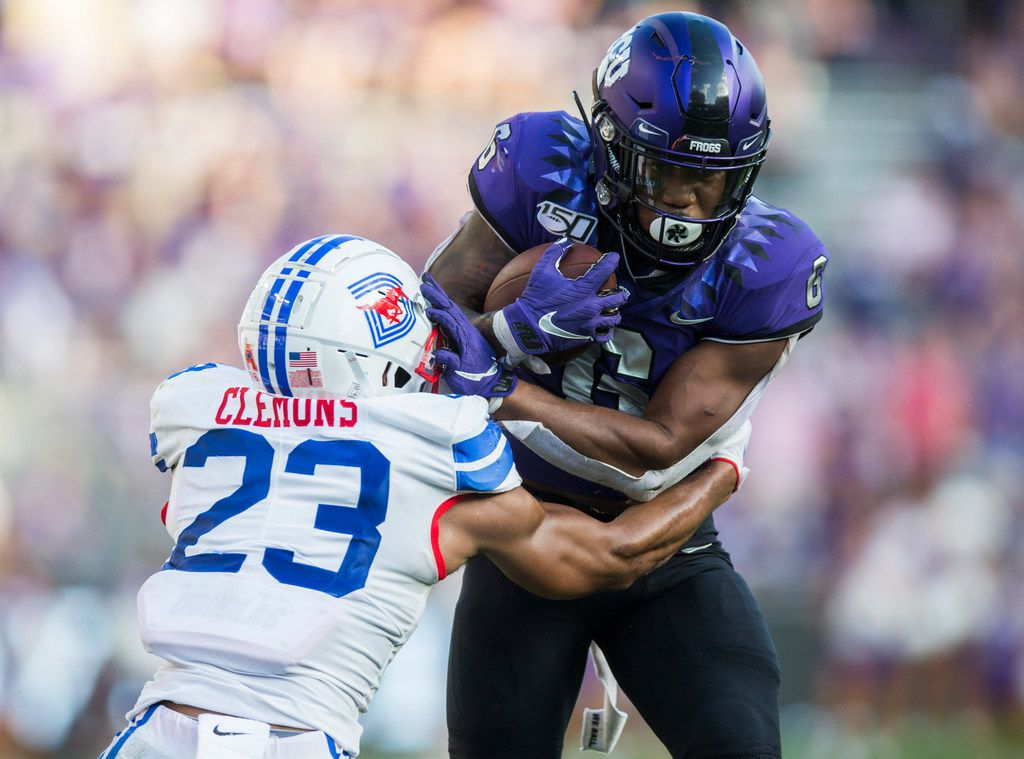 TCU Horned Frogs running back Darius Anderson (6) is tackled by Southern Methodist Mustangs safety Rodney Clemons (23) during the fourth quarter of a college football game between SMU and TCU on Saturday, September 21, 2019 at Amon G. Carter Stadium in Fort Worth.