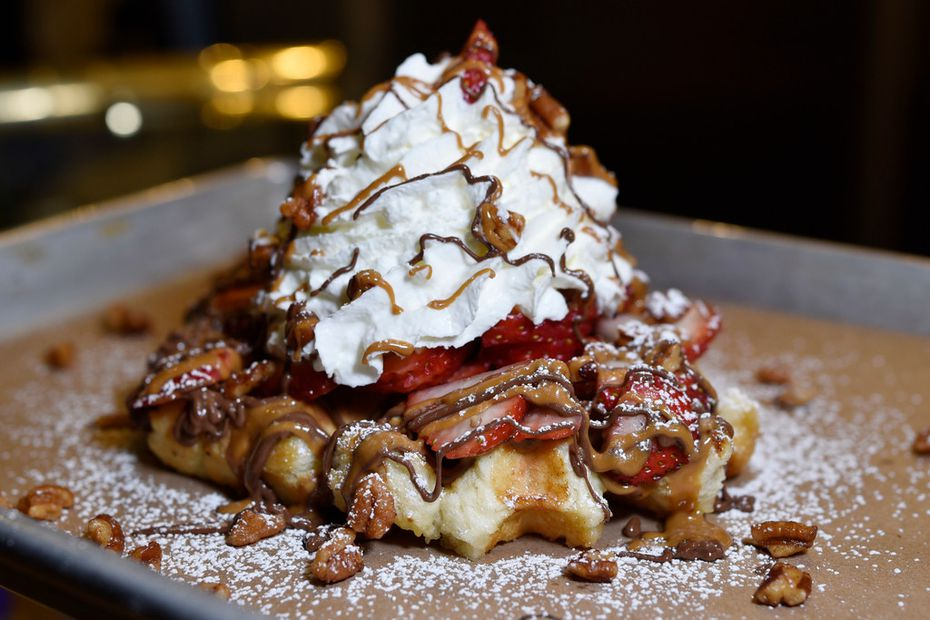 Caleb Lewis' favorite waffle is The House with strawberries, Nutella, cookie butter, whipped cream and candied pecans.