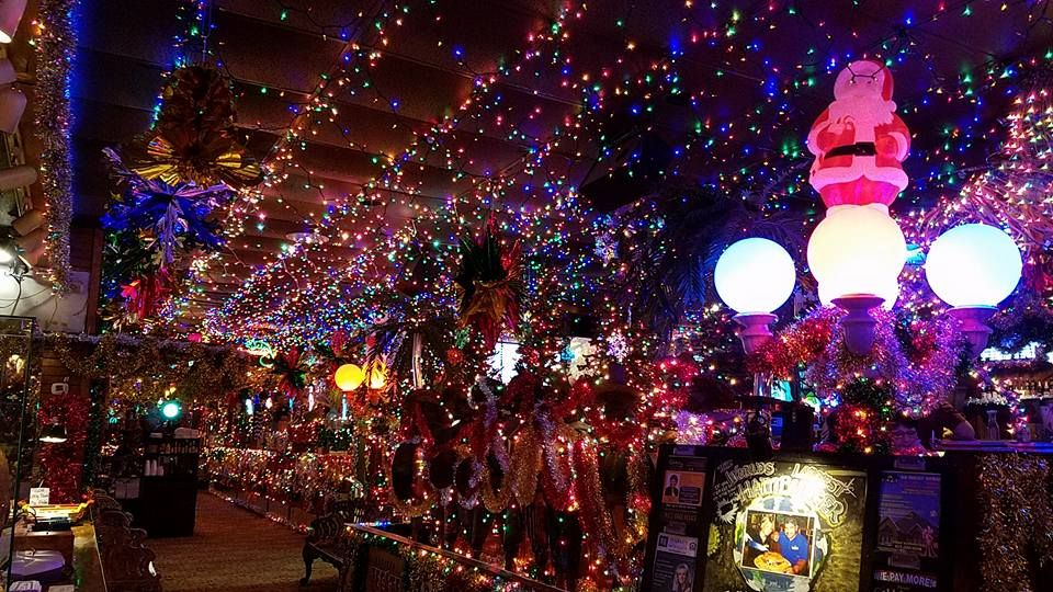 Christmas lights run along the ceiling at Campo Verde in Arlington. The Mexican restaurant has been celebrating and decorating restaurant since the 1980s.