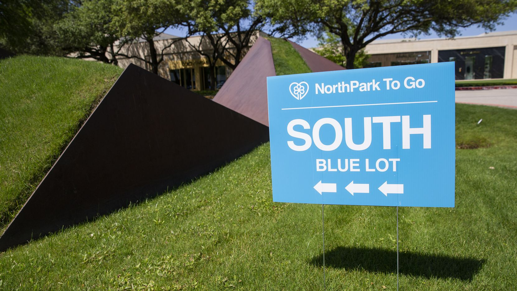 """NorthPark To Go signs direct customers to the blue lot for order pickups per Texas Gov. Greg Abbott's """"retail-to-go"""" phase of reopening the state's economy starting Friday, April 24, 2020."""