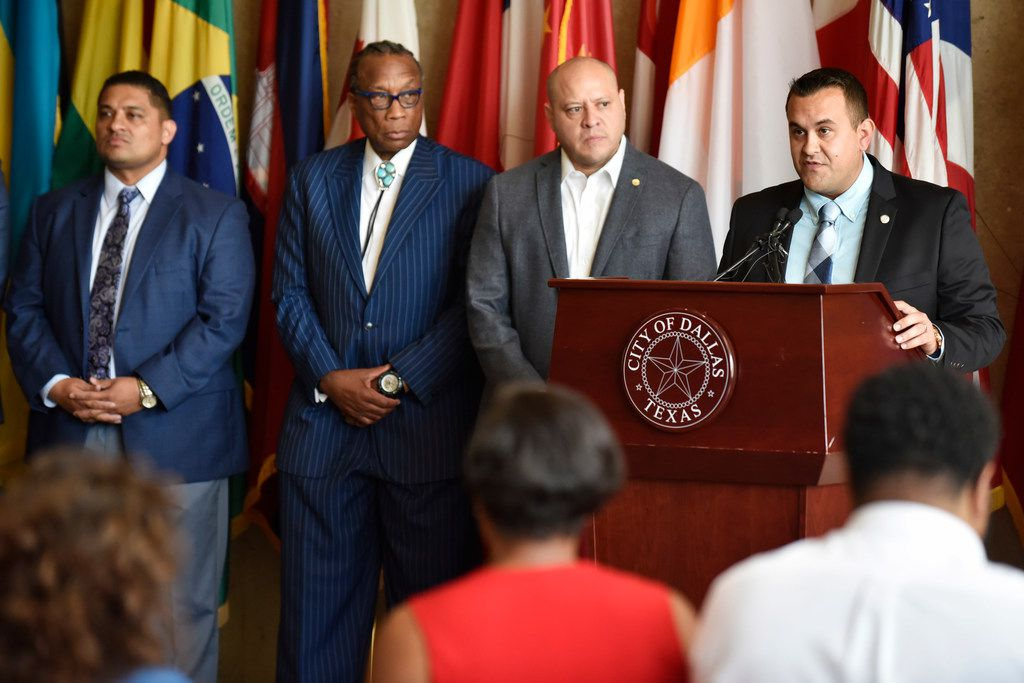 City councilman Adam Bazaldua of District 7, right, conducts a press conference with other city council members as they speak out about the heavy presence of troopers in South Dallas, Thursday Aug. 01, 2019 at Dallas City Hall. Ben Torres/Special Contributor