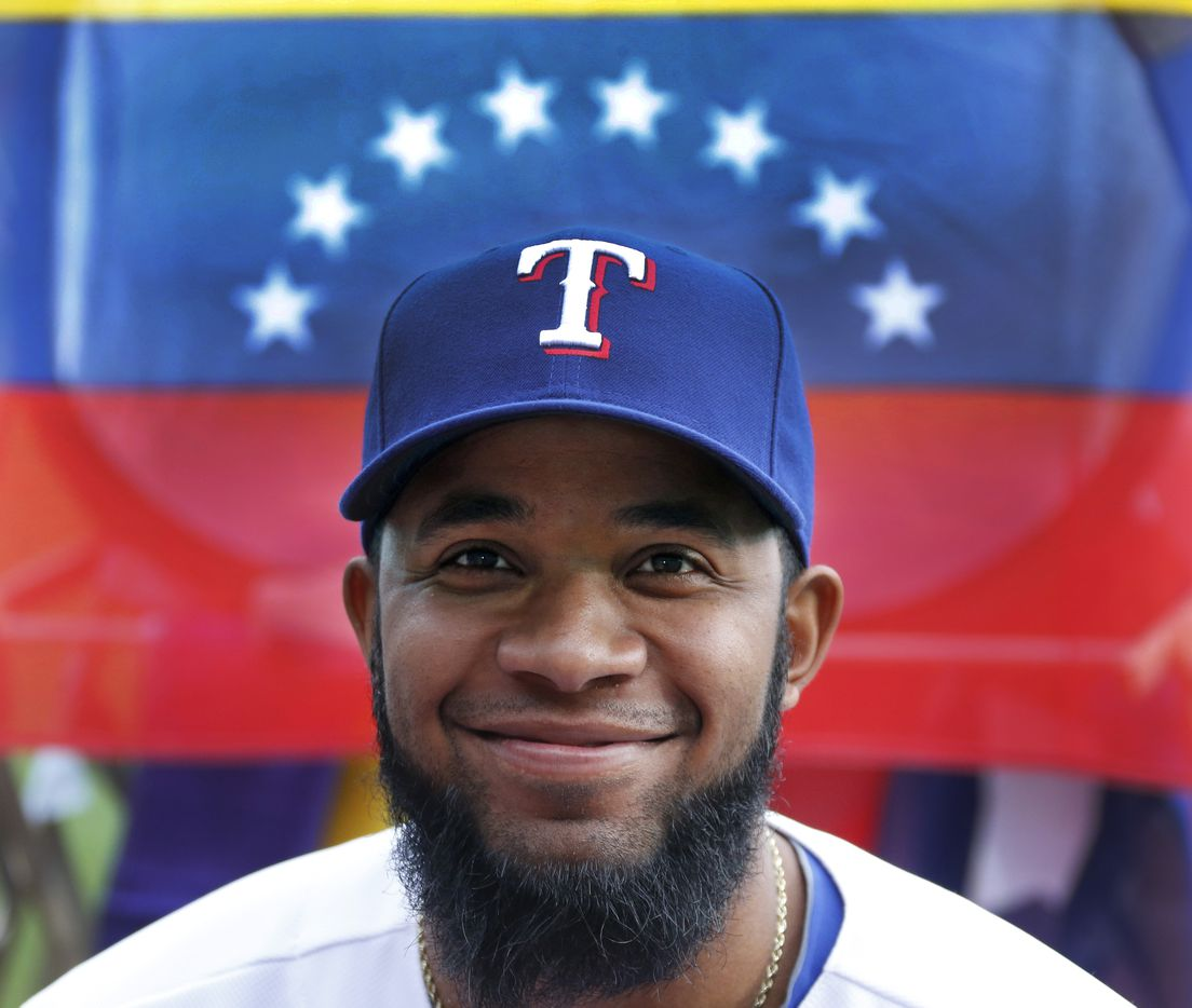 Texas shortstop Elvis Andrus poses with the Venezuelan flag at photo day during Texas Rangers baseball spring training in Surprise, AZ  on Tuesday, February 25, 2014.  (Louis DeLuca/Dallas Morning News) 03302014xRANGERS/MLBpreview