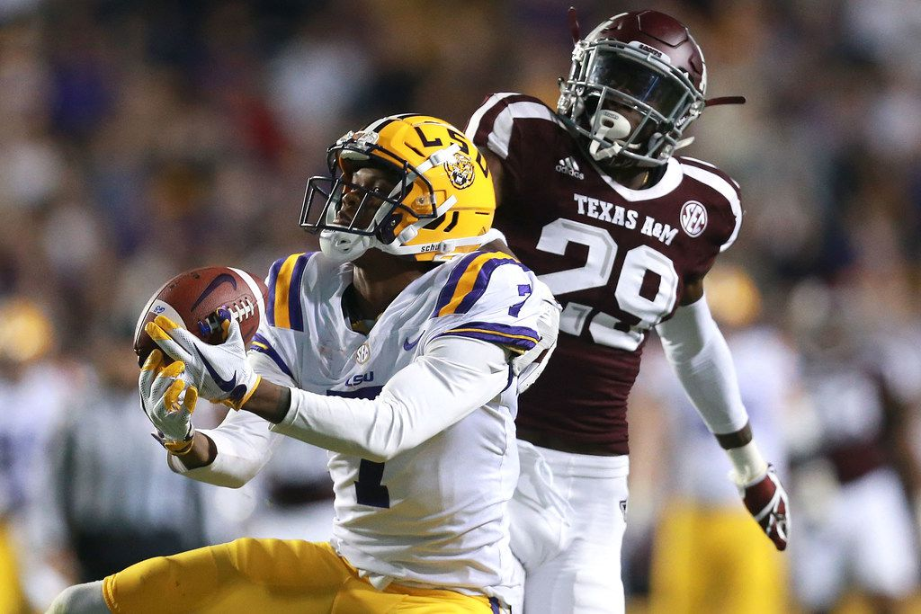 Editor's BATON ROUGE, LA - NOVEMBER 25: Donte Jackson #1 of the LSU Tigers catches a pass over Debione Renfro #29 of the Texas A&M Aggies during the first half at Tiger Stadium on November 25, 2017 in Baton Rouge, Louisiana. (Photo by Sean Gardner/Getty Images)