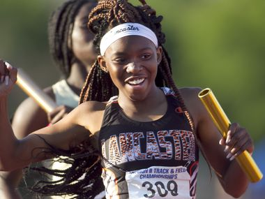 Lancaster's Addison Stricklin was all smiles as she carried the baton across the finish line to win the Class 5A Girls 4X200 Meter Relay event. The  Class 6A Region 1 and Class 5A Region ll track and field meets were held at UTA' s Maverick Stadium in Arlington on April 24, 2021. (Steve Hamm/ Special Contributor)