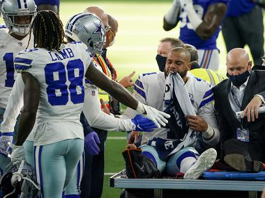 Dallas Cowboys quarterback Dak Prescott leaves the field on a cart after beig injured on a tackle by New York Giants cornerback Logan Ryan during the third quarter of an NFL football game at AT&T Stadium on Sunday, Oct. 11, 2020, in Arlington. Prescott was injured o the play when Ryan came down on his right leg and left the game. (Smiley N. Pool/The Dallas Morning News)