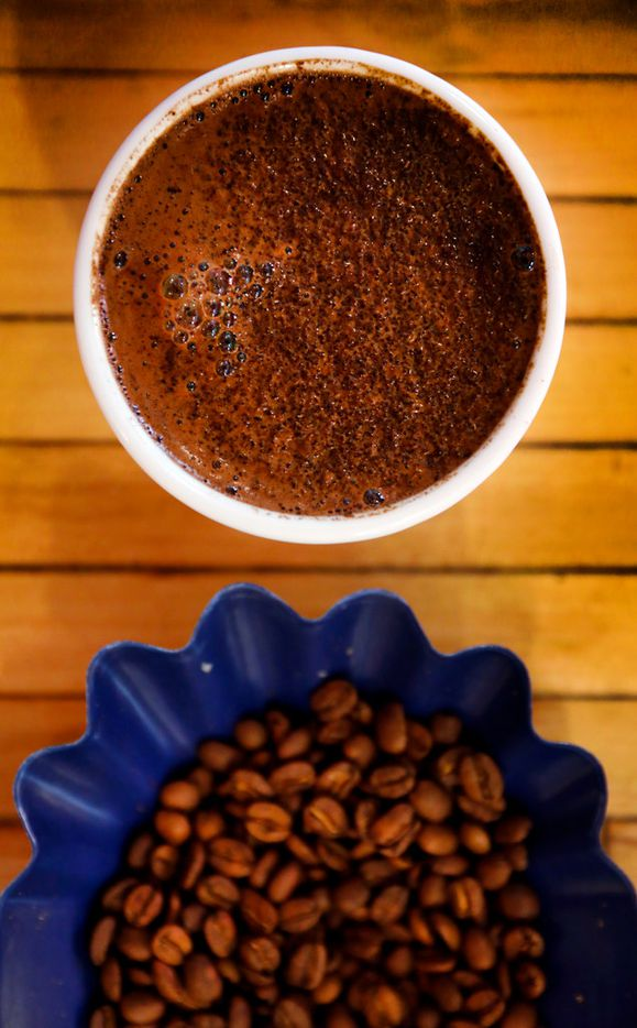 Ascension Coffee beans and a fresh made cup is prepared for cupping at the headquarters in Dallas, Thursday, July 26, 2018.  (Tom Fox/The Dallas Morning News)