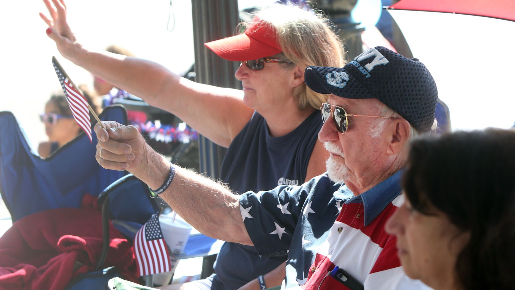 Stan Dimmick of Arlington waves an American flag in front of Arlington City Hall. Dimmick has been to all 52 4th of July Parades in the city. (Steve Hamm/Special Contributor)