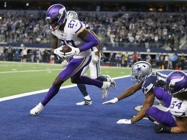 FILE - Vikings safety Jayron Kearse (27) intercepts a pass in the end zone during the second half of a game against the Cowboys at AT&T Stadium in Arlington on Sunday, Nov. 10, 2019.