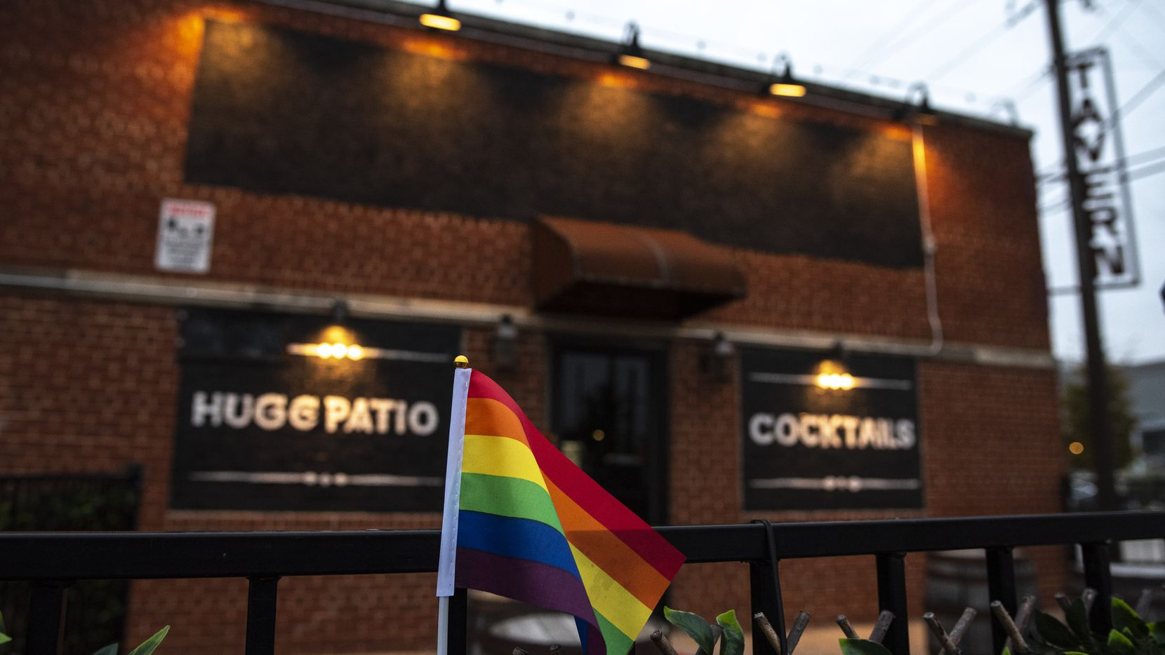 """On Oct. 24, 2020, protesters hung a gay-pride flag outside of Redfield's Tavern in Dallas. LGBTQ+ community members protested outside the tavern after the co-owner said he didn't want the bar to be an """"overtly gay"""" place."""