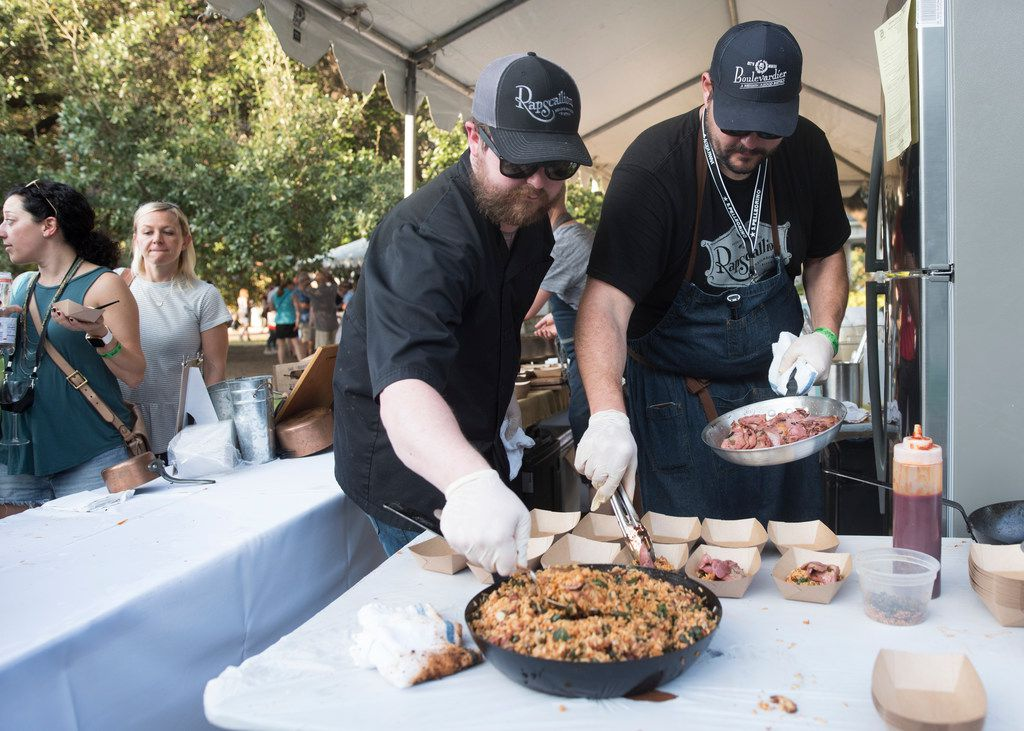 Rapscallion's chef de cuisine Brian Casner and executive chef Nathan Tate prepare beef tongue and fried rice during Chefs for Farmers.