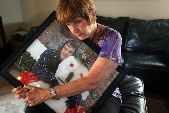 Kathy O'Keefe's son, Brett, died in their Flower Mound home from a drug overdose in 2010. She's holding a picture taken shortly before his death. A new program by the Flower Mound Police Department is designed to get families the help they need before it's too late.