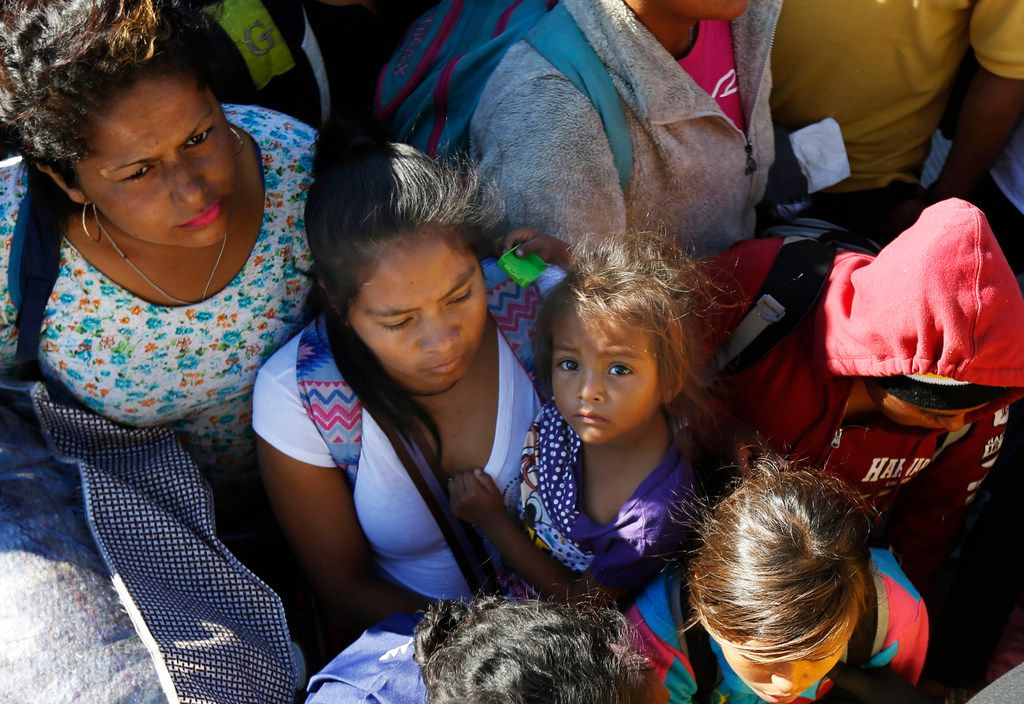 Migrants traveling with a caravan hoping to reach the U.S. border, wait to board a bus in La Concha, Mexico, Wednesday, Nov. 14, 2018. Buses and trucks are carrying some migrants into the state of Sinaloa along the Gulf of California and further northward into the border state of Sonora. The bulk of the main caravan appeared to be about 1,100 miles from the border, but was moving hundreds of miles per day.