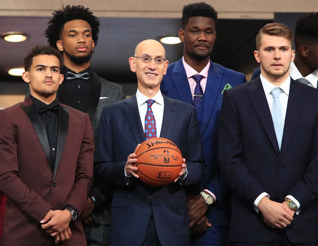 NEW YORK, NY - JUNE 21: NBA Commissioner Adam Silver (C) poses with NBA Draft Prospects Trae Young, Marvin Bagley III, Deandre Ayton and Luka Doncic before the 2018 NBA Draft at the Barclays Center on June 21, 2018 in the Brooklyn borough of New York City. NOTE TO USER: User expressly acknowledges and agrees that, by downloading and or using this photograph, User is consenting to the terms and conditions of the Getty Images License Agreement.  (Photo by Mike Lawrie/Getty Images)