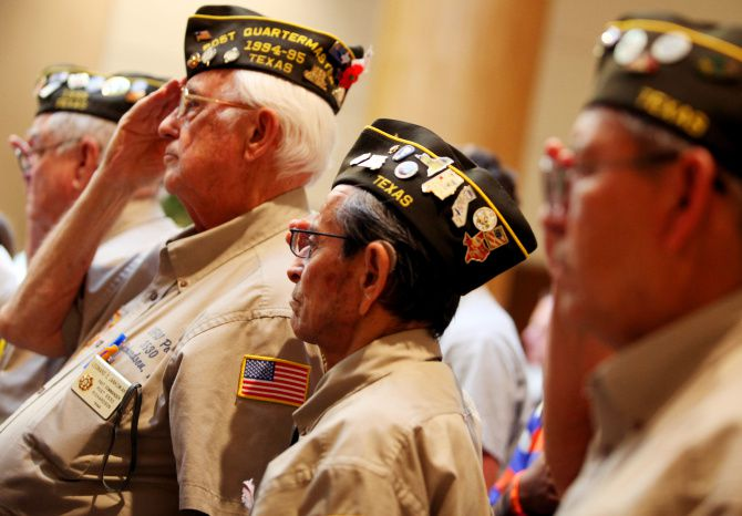 Korean War veterans (from left) Leonard C. Jankowiak,  Ray Gonzales and Pablo Gonzalez, all with VFW Post 3530, saluted during the national anthem Sunday at the Dallas VA Medical Center during a service marking the 60th anniversary of the end of the war.