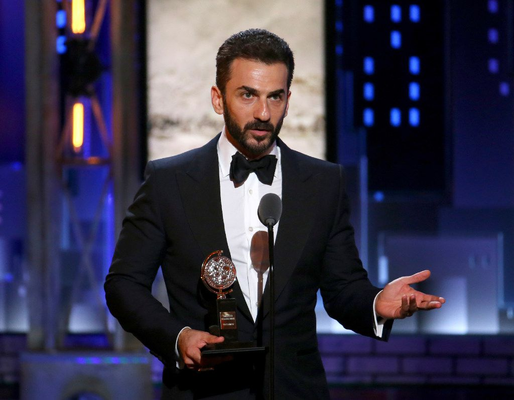 """Michael Aronov accepts the award for best performance by an actor in a featured role in a play for """"Oslo"""" at the 71st annual Tony Awards on Sunday, June 11, 2017, in New York. (Photo by Michael Zorn/Invision/AP)"""