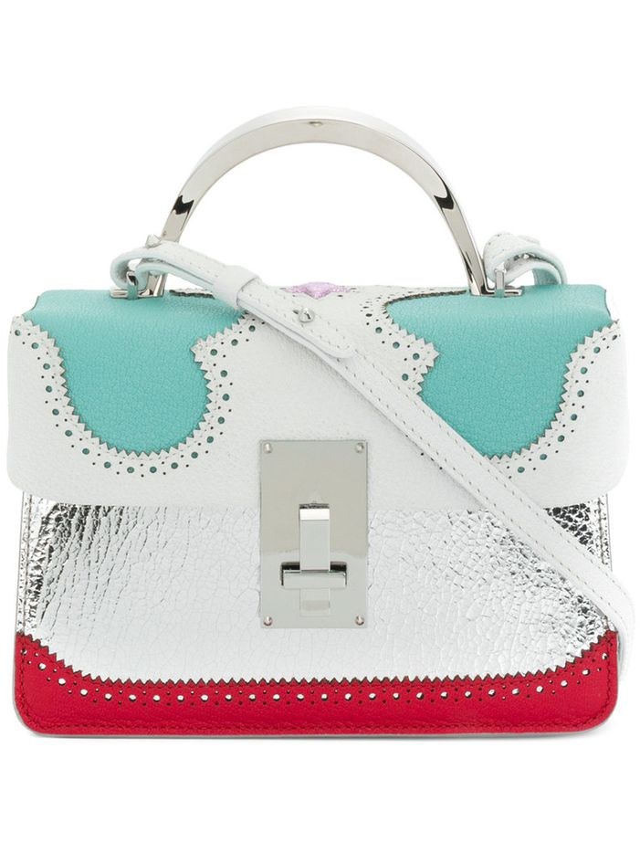 A portion of every item purchased from the Mothership shop-in-shop will be donated to an effort to help women and children in war-torn countries. Handbag from The Volon, $1,265.
