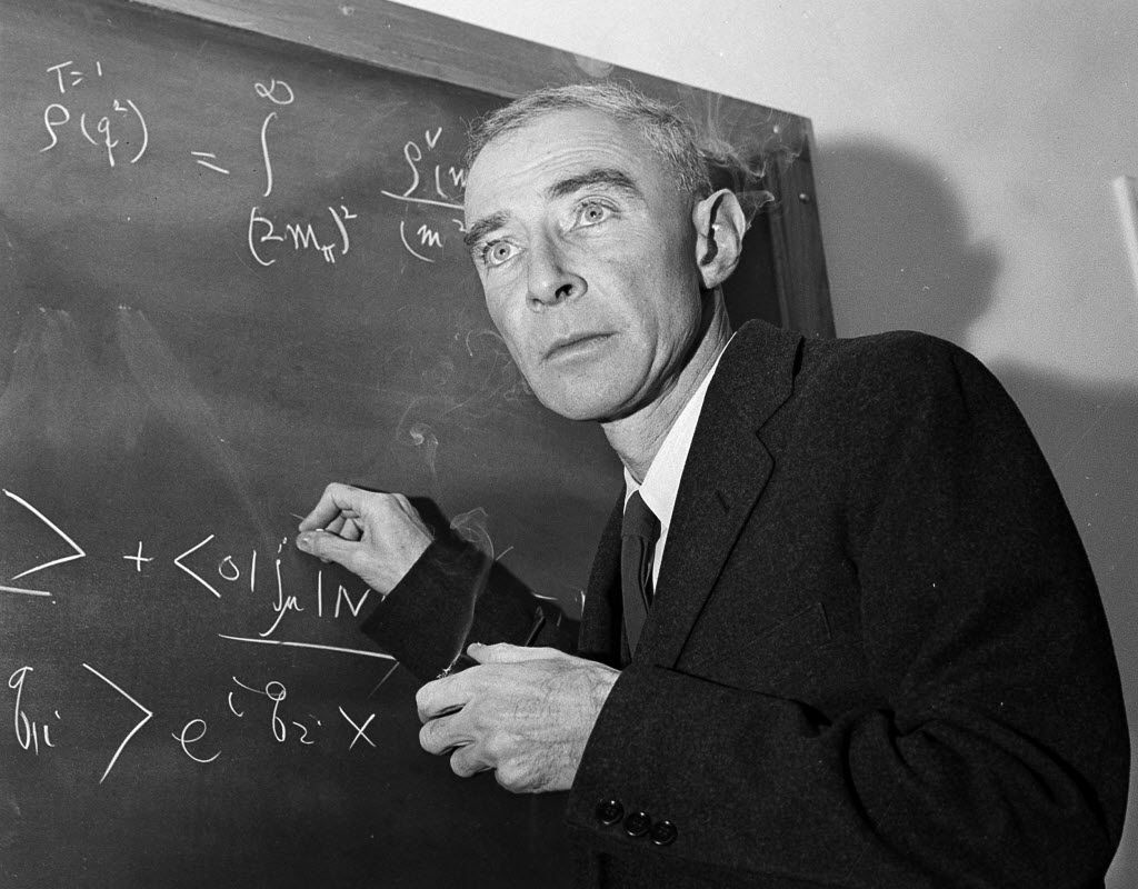 In this Dec. 15, 1957, file photo, Dr. J. Robert Oppenheimer, director of the Manhattan Project, which created the atomic bomb, is shown at his study in Princeton University's Institute for Advanced Study, Princeton, N.J.