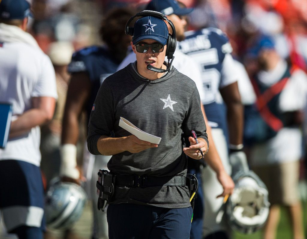 Dallas Cowboys offensive coordinator Kellen Moore talks on his headset on the sideline during the fourth quarter of an NFL game between the Dallas Cowboys and the Washington Redskins on Sunday, September 15, 2019 at FedExField in Landover, Maryland. (Ashley Landis/The Dallas Morning News)