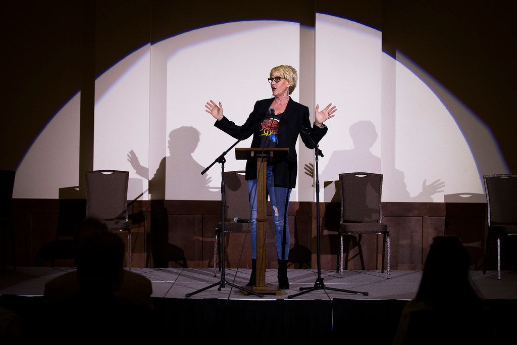 Environmental activist Erin Brockovich addresses a town hall style meeting at Frisco Celebration Hall on Thursday.