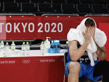 Slovenia's Luka Doncic (77) sits dejected after losing to France 90-89 in a men's basketball semifinal at the postponed 2020 Tokyo Olympics at Saitama Super Arena, on Thursday, August 5, 2021, in Saitama, Japan. France defeated Slovenia 90-89. Slovenia will play in the bronze medal game.