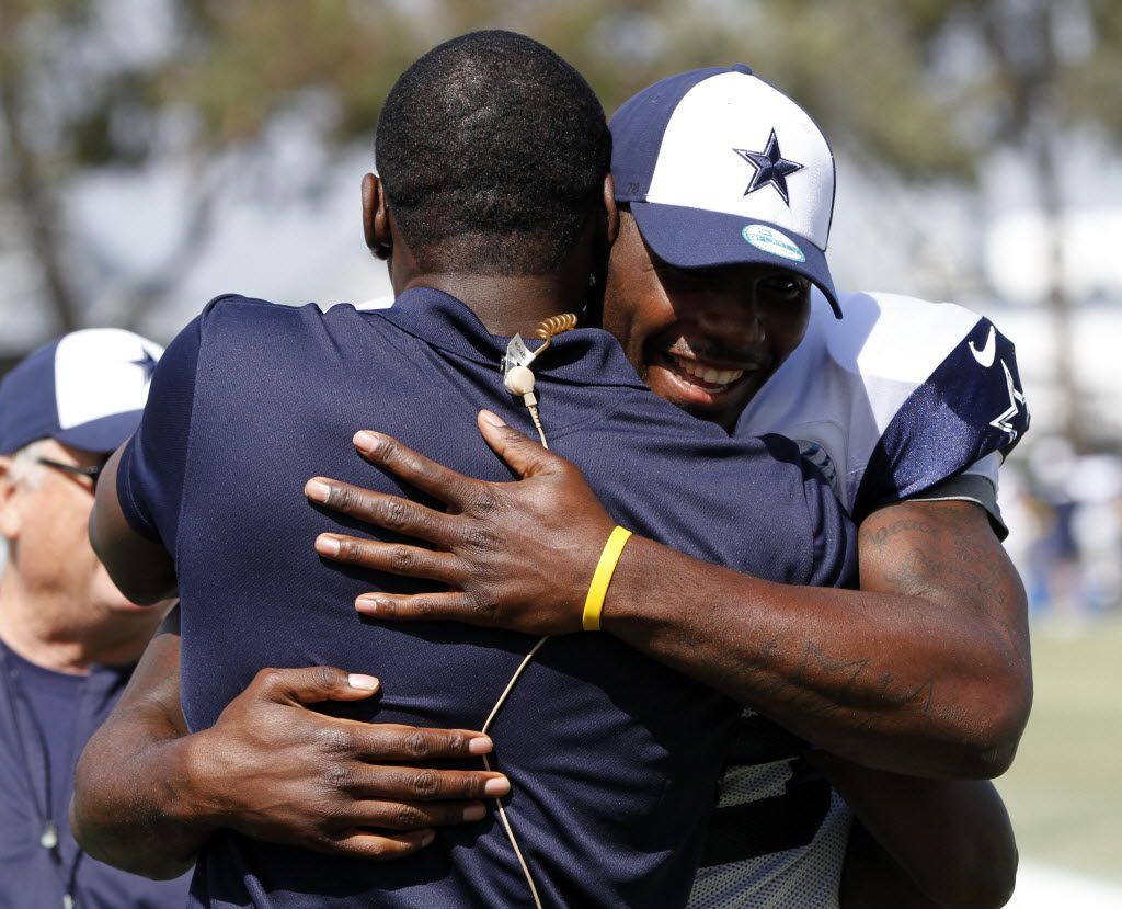 Dallas Cowboys wide receiver Dez Bryant (88) hugs former Dallas Cowboys player Michael Irvin after the afternoon practice at Dallas Cowboys training camp in Oxnard, California on July 24, 2013. (Vernon Bryant/The Dallas Morning News)