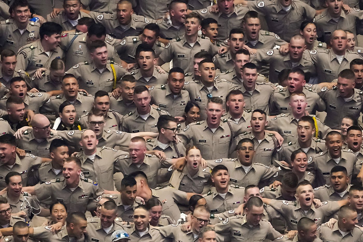 Members of the Texas A&M Corps of Cadets sing the Aggie War Hymn before an NCAA football game against Arkansas at AT&T Stadium on Saturday, Sept. 25, 2021, in Arlington.