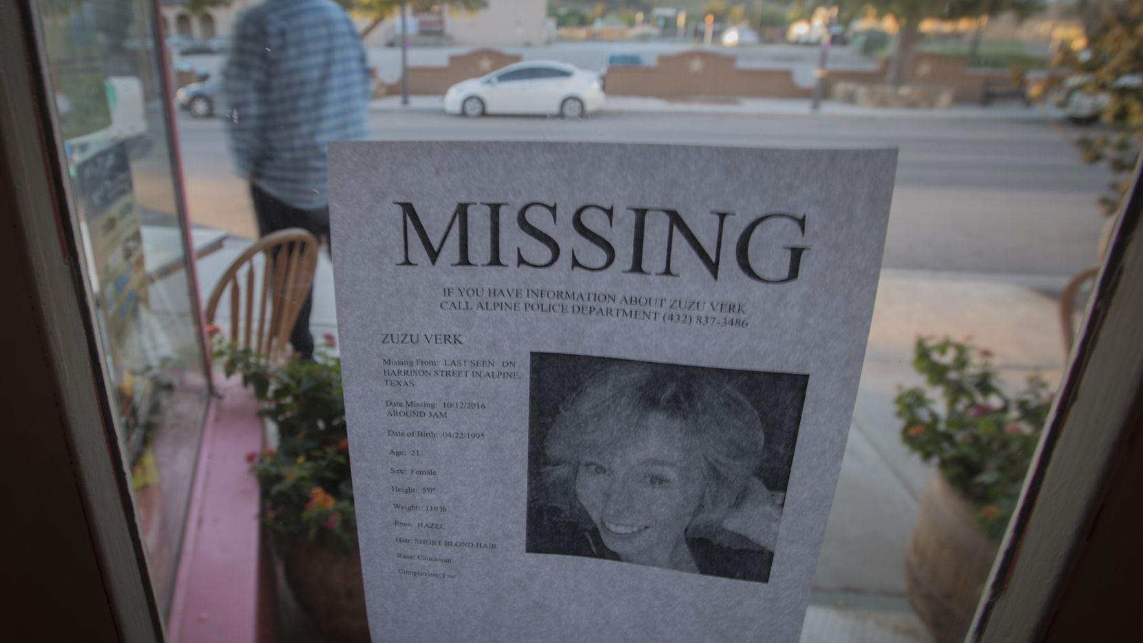 A flier taped to the window of a business in Alpine gives a full description of Zuzu Verk, a Sul Ross University junior who was last seen in October. (Robert W. Hart/Special Contributor)
