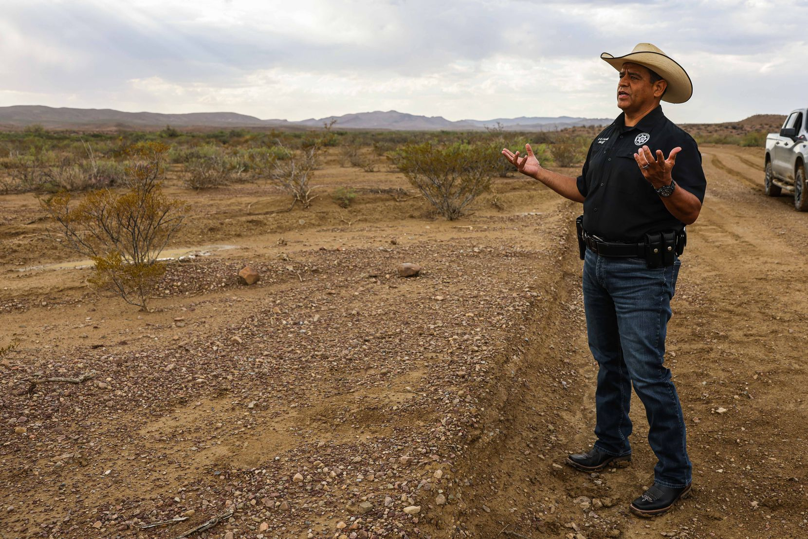 Culberson County Sheriff Oscar Carrillo stands by the spot where the body of 15-year-old Christian was found on June 21, 2021.
