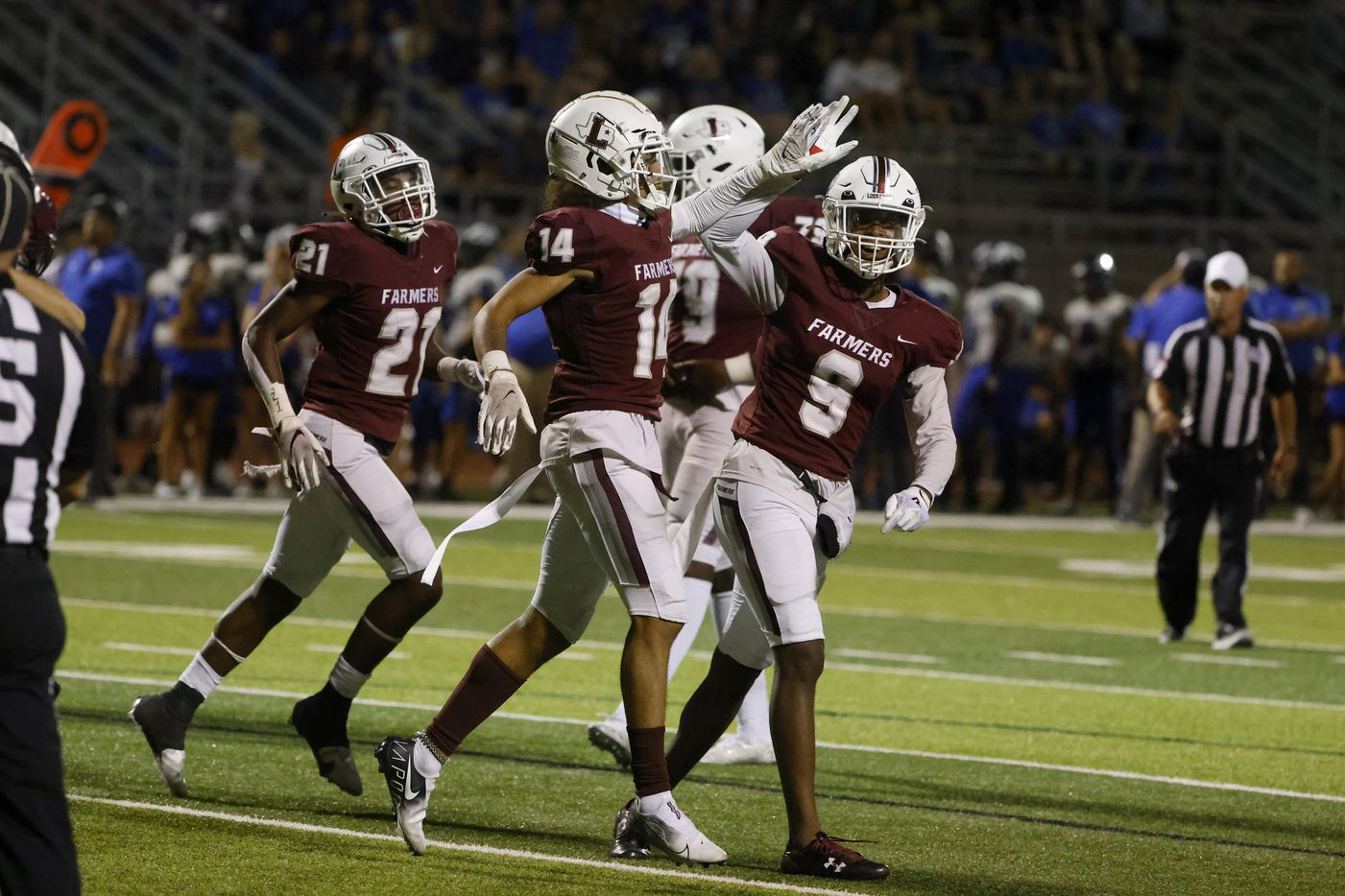 Lewisville wide receiver Kye Stone (14) gets congratulated by Armani Winfield after scored on an offensive fumble at the goalie against Plano West during the first half of a high school football game in Lewisville, Texas on Friday, Sept. 24, 2021. (Michael Ainsworth/Special Contributor)