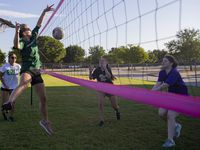 The Arlington High volleyball team practices on its grass court Thursday morning. The team isn't allowed to work out indoors because of county restrictions. (Juan Figueroa/ The Dallas Morning News)