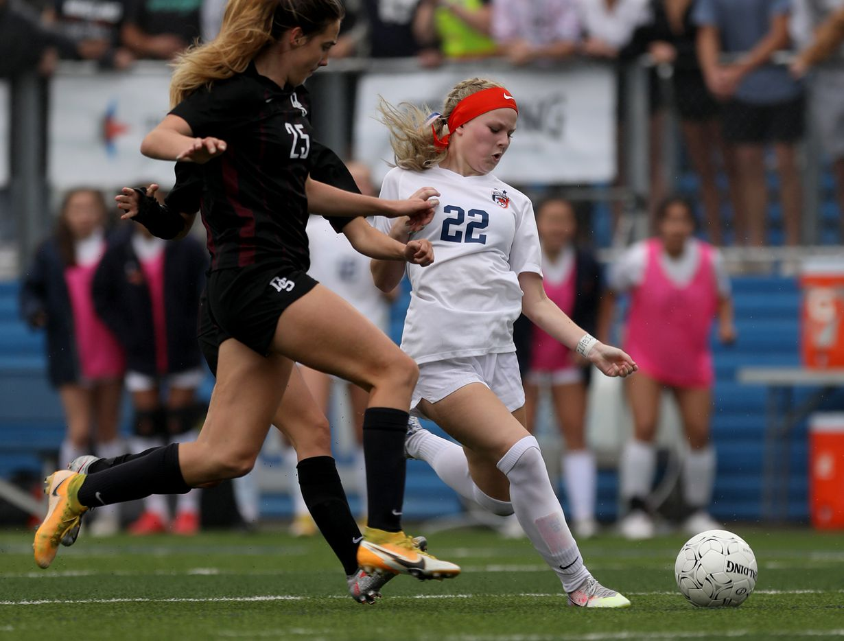 Wakeland's McKenna Jenkins (22) goes for the ball ahead of Dripping Springs' Laney Kalsu (25) during their UIL 5A girls State championship soccer game at Birkelbach Field on April 16, 2021 in Georgetown, Texas.  (Thao Nguyen/Special Contributor)