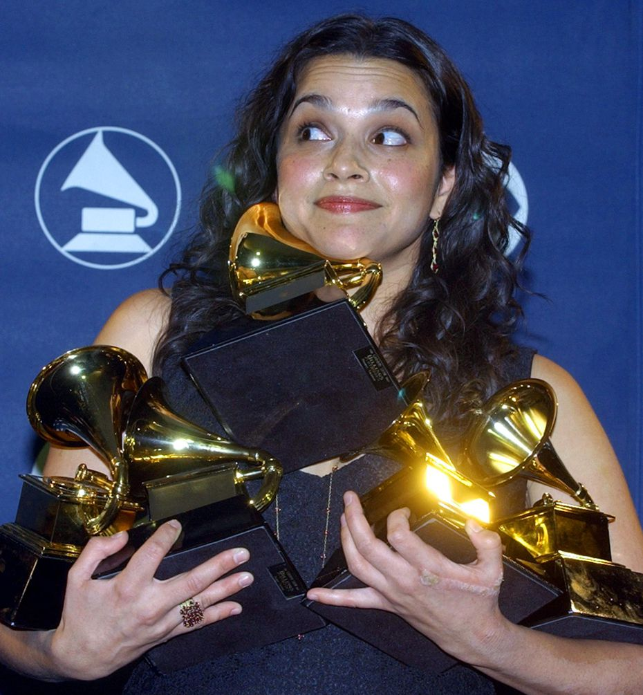 Norah Jones holds up her five Grammy Awards during the 45th annual Grammy Awards on Feb. 23, 2003 at Madison Square Garden in New York.