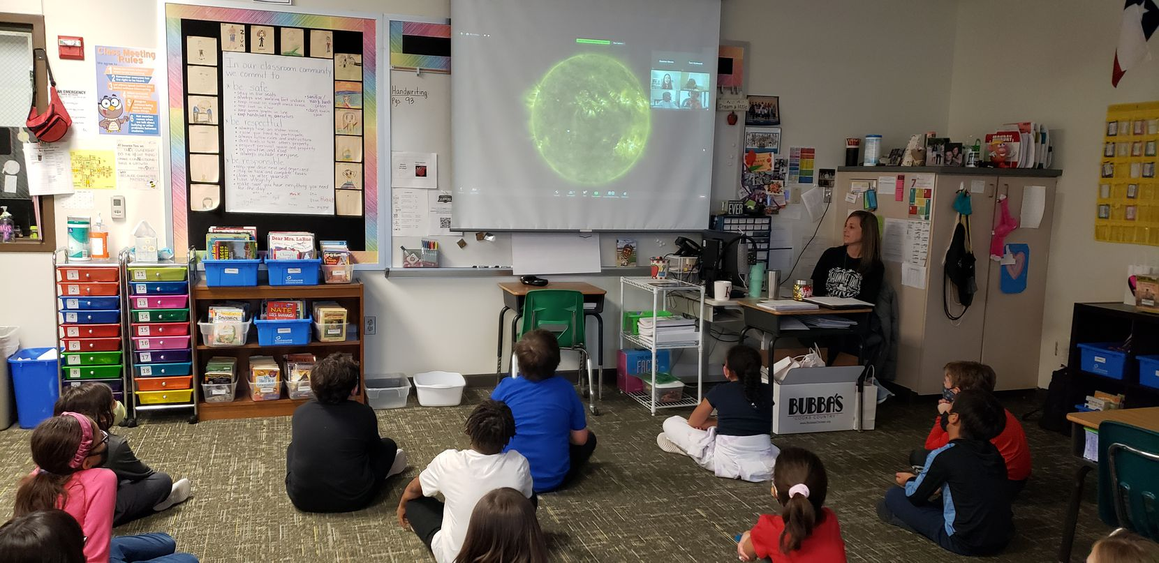 Sarah Fromhold, a digital learning coach at Shawnee Trail Elementary in Frisco ISD, shows a video session to third-graders to teach them about space. Nepris provides the videos from professionals like this one from Kelly Korreck, an astrophysicist at the Harvard Smithsonian Center for Astrophysics in Cambridge, Mass.