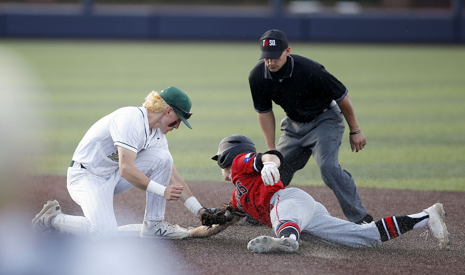 Birdville's Logan Lacey, left, is unable to make the tag as Mansfield Legacy's Easton Steenbakkers (3) slides into second during the seventh inning of a high school Class 5A Region I quarterfinal series baseball game at Dallas Baptist University, Thursday, May 20, 2021. Birdville won 2-0. (Brandon Wade/Special Contributor)