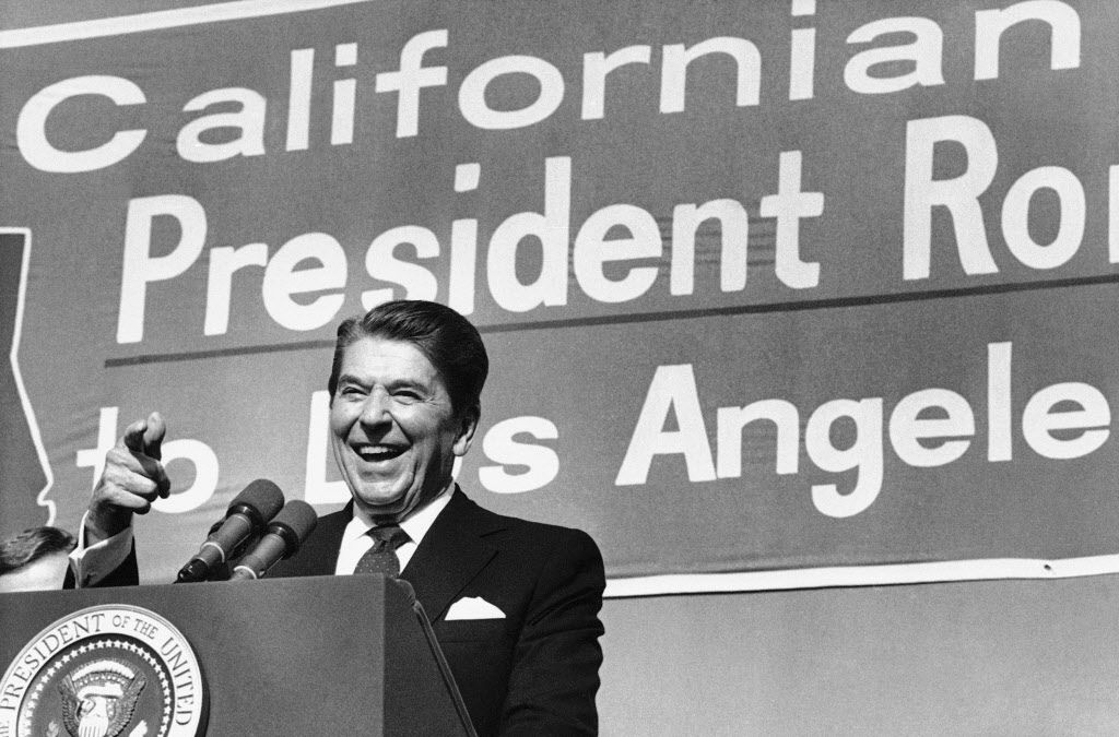 In this Monday, Nov. 5, 1984 file photo, President Ronald Reagan points toward the crowd as he speaks during a rally at Pierce College in the Woodland Hills area of Los Angeles. AP Photographer Nick Ut will be retiring from the AP in March 2017 after 51 years of taking photographs from the front lines of the Vietnam War to the red carpets of Hollywood.