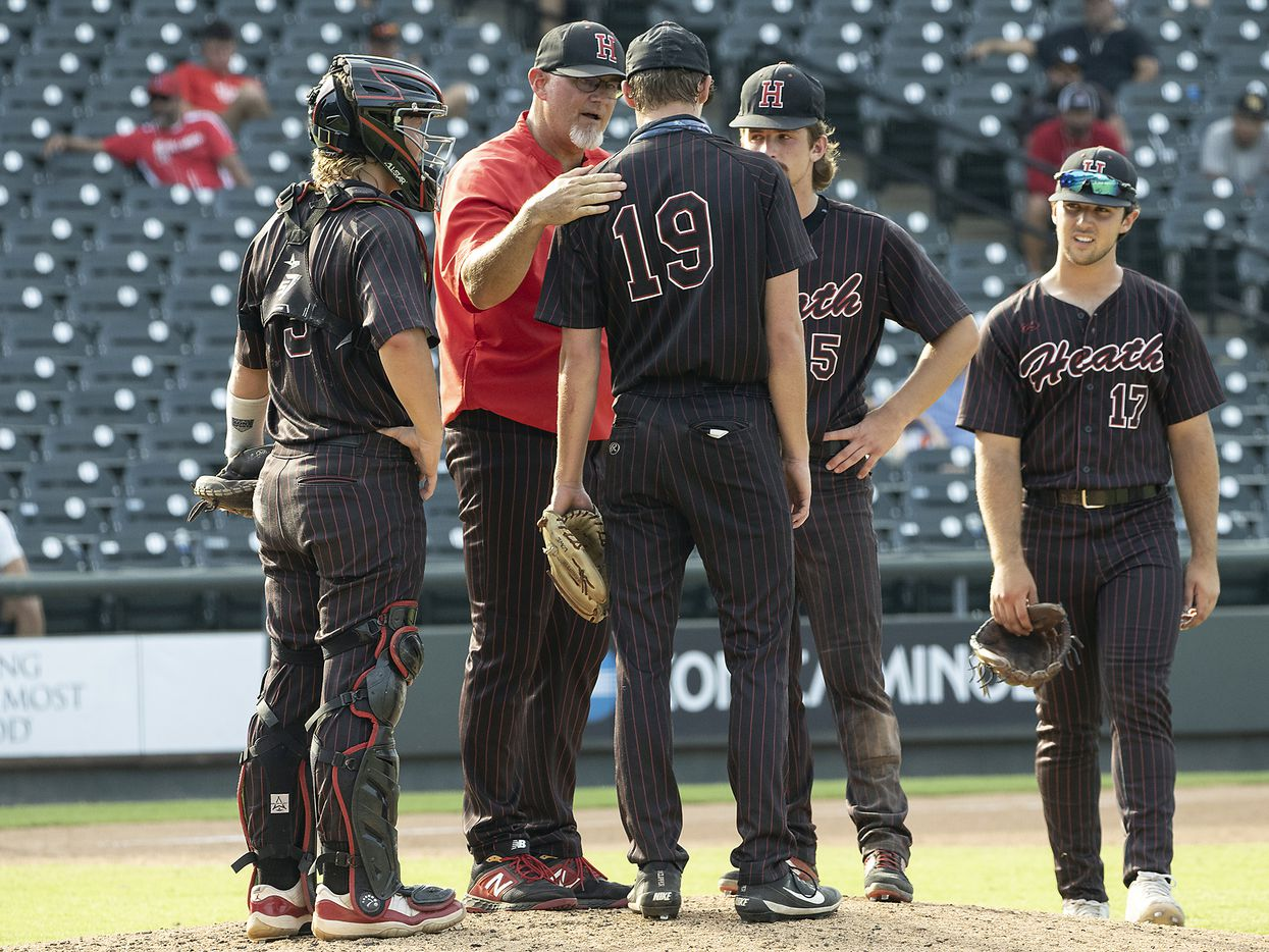 Rockwall-Heath head coach, Greg Harvey, pulls pitcher, Johnny Lowe, (19), and moves to infield agasint Keller during the sixth inning of the 2021 UIL 6A state baseball final held, Saturday, June 12, 2021, in Round Rock, Texas.  Rockwall-Heath defeated Keller 4-3.   (Rodolfo Gonzalez/Special Contributor)