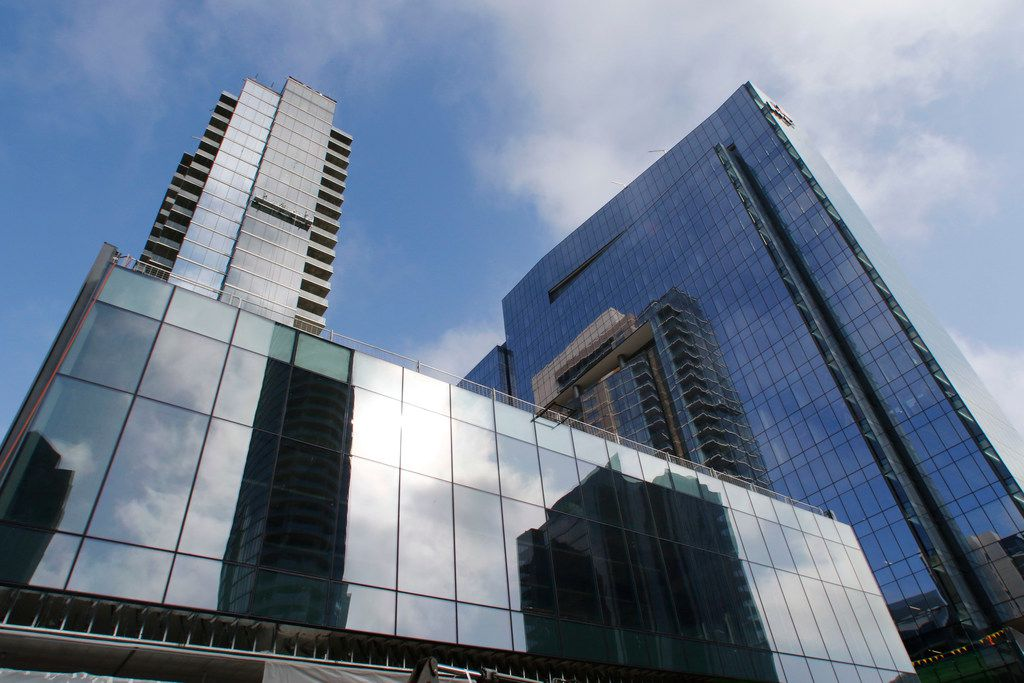 The Trammell Crow Company will open their 34-story residential tower, Residences at Park District, left, and their 20-story office tower, PwC Tower at Park District in the fall of 2018 in downtown Dallas. The tower features 228 luxury apartment units with 13,000 SF of ground floor retail. The retail space will have 20' floor-to-floor glass on two levels. Both  towers are connected via a plaza designed by The Office of James Burnett, the landscape architecture firm that designed Klyde Warren Park. Photo taken, Thursday, March 29, 2018. (David Woo/The Dallas Morning News)
