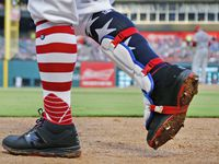 FILE - Rangers second baseman Rougned Odor (12) sports patriotic socks during a game against the Boston Red Sox at Globe Life Park in Arlington on Tuesday, July 4, 2017.