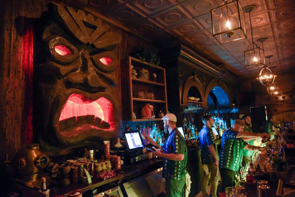 Bartenders at Pilikia, a tiki bar on Ross Ave., open in the former Three Sheets location prepare cocktails on Friday, Jan. 27, 2017.